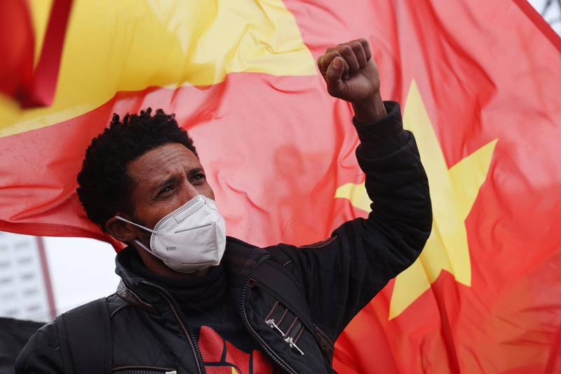 BERLIN, GERMANY - MAY 07: A protester raises his fist during a demonstration against Ethiopia's war against Tigray regional forces near the Chinese Embassy on May 07, 2021 in Berlin, Germany. The protesters were also demanding the Chinese government stop supporting the Ethiopian government. The Tigray War began in 2020 and is ongoing. (Photo by Sean Gallup/Getty Images)