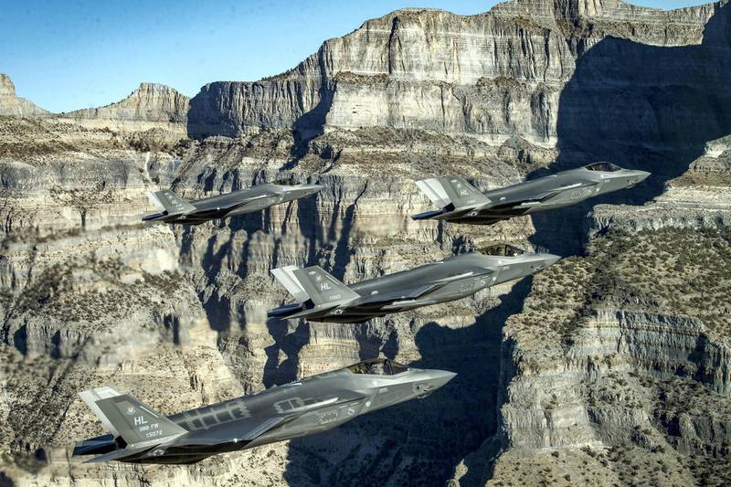 A formation of U.S. Air Force F-35 Lightning II fighter jets perform aerial maneuvers during as part of a combat power exercise over Utah Test and Training Range, Utah, U.S. November 19, 2018. Picture taken November 19, 2018. U.S. Air Force/Staff Sgt. Cory D. Payne/Handout via REUTERS. ATTENTION EDITORS - THIS IMAGE WAS PROVIDED BY A THIRD PARTY