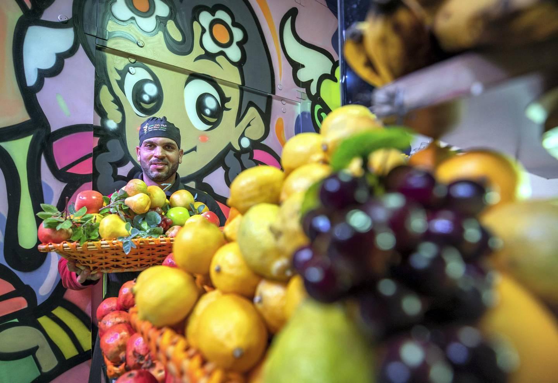 Abu Dhabi, United Arab Emirates, October  11, 2020.  Khalidiya by night article by Saeed Saeed on restaurants, café's on Al Yahar Street.  Mounes Riffai at his juice bar, Fruit Blend.Victor Besa/The NationalSection:  NAReporter:  Saeed Saeed