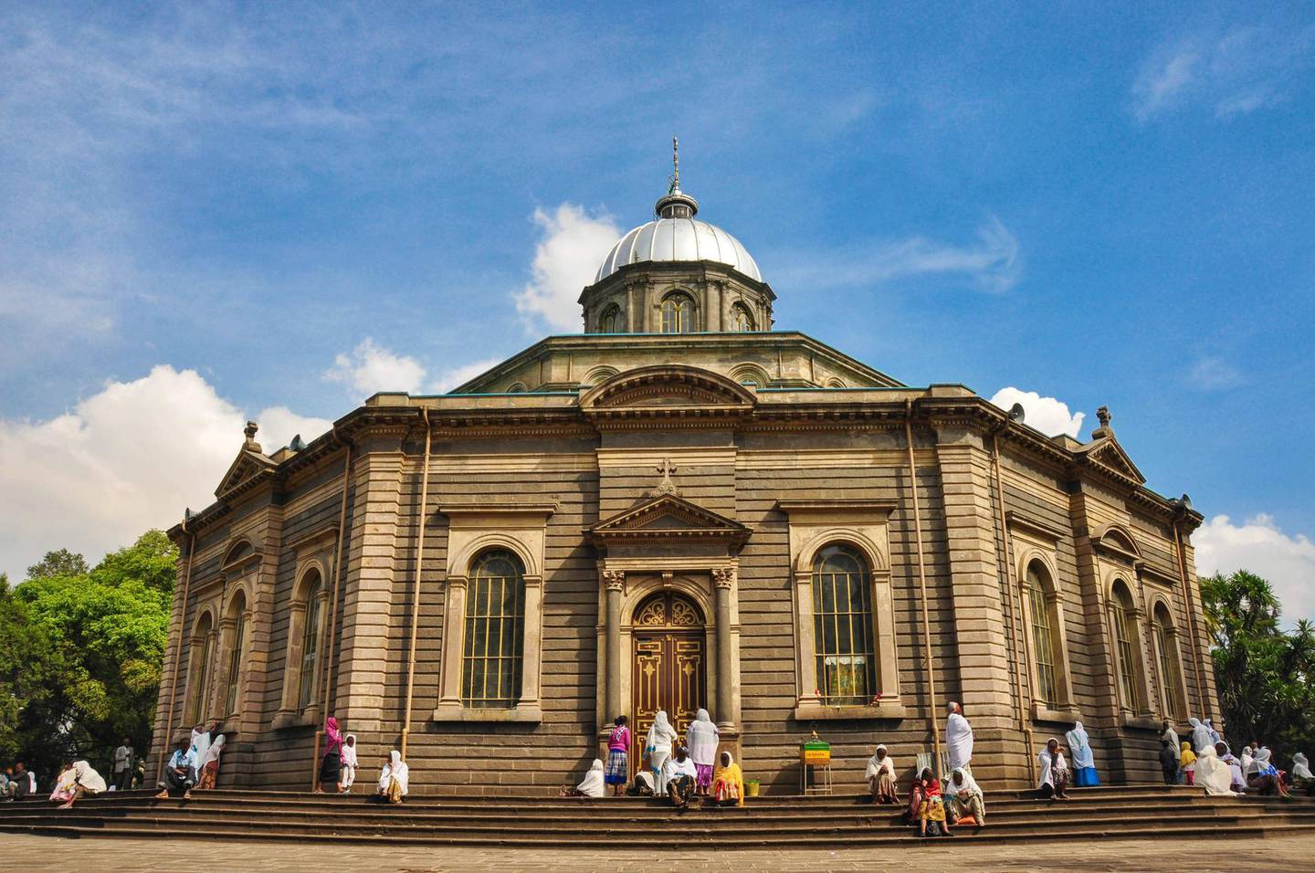 St George Church is an Orthodox cathedral in Addis Ababa, Ethiopia. It has distinctive octagonal form.Everyday, but especially on sunday the believers are gathering and praying in and outside around the church. Women and girls are covering their heads and shoulders with white scarfs. Getty Images