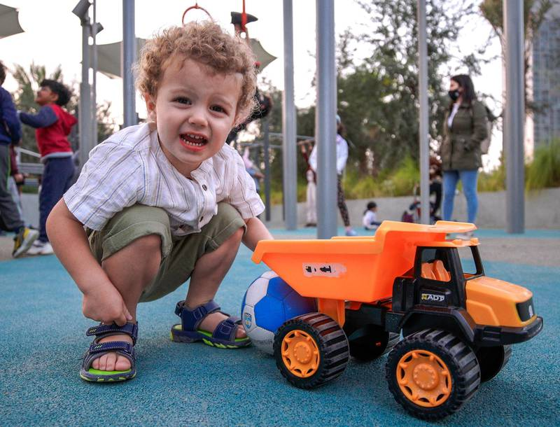 Abu Dhabi, United Arab Emirates, January 21, 2021.  Charlie, 2, plays with his truck at the kiddie play area in Al Fay Park on Reem Island.Victor Besa/The National Section:  LFReporter: Panna Munyal