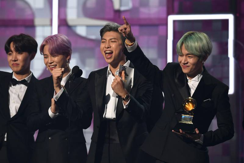 South Korean band BTS presents the award for Best R&B Album during the 61st Annual Grammy Awards on February 10, 2019, in Los Angeles.  / AFP / Robyn Beck