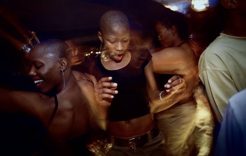 Unidentified young black yuppies dance and party at Who's Zoo, a popular nightclub in Fourways, an affluent suburb in Johannesburg, South Africa. After more than a decade democracy, a new black middleclass and elite is growing rapidly, and they have money to spend on houses, cars and entertainment. Getty Images