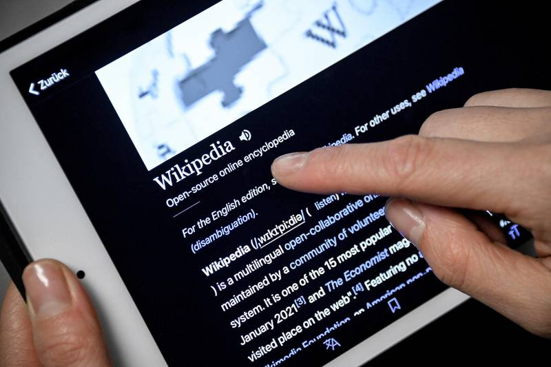 epa08935991 A close-up image shows a woman using the Wikipedia online encyclopedia on an iPad, in Cologne, Germany, 13 January 2021. The online encyclopedia Wikipedia was launched on 15 January 2001 by co-founder Jimmy Wales and is now one of the most visited website on the Internet. There are articles in around 300 languages, its service is still non-commercial, and the non-profit organization is financed solely by donations. More than three million volunteers write, edit and check the articles. Wikipedia has become a kind of basic knowledge of the world.  EPA/SASCHA STEINBACH