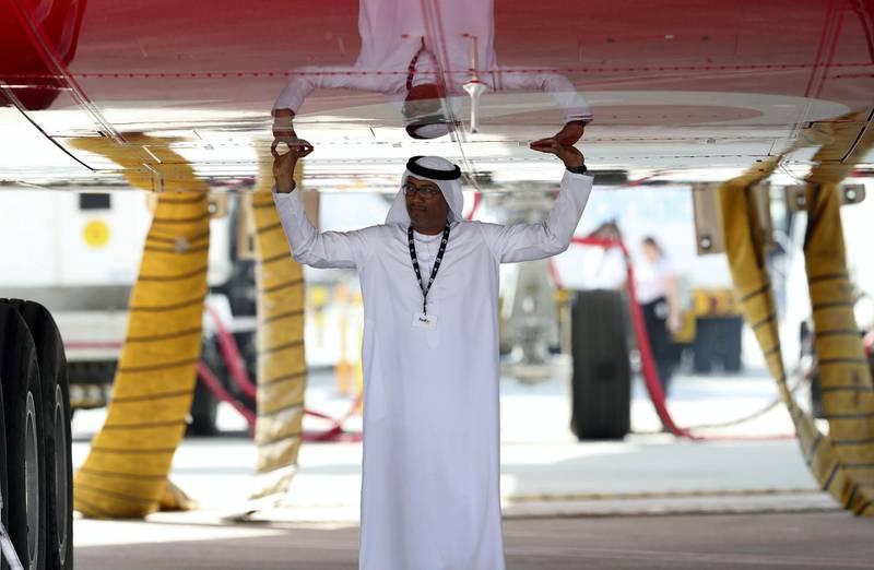 Dubai, United Arab Emirates - November 14th, 2017: A visitor under an A380 at the Dubai airshow. Tuesday, November 14th, 2017 at Al Maktoum Airport, Dubai. Chris Whiteoak / The National