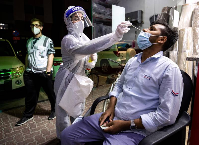 Abu Dhabi, United Arab Emirates, March 9, 2021. Tamouh Health Care conducts free PCR home testing.  A team visits residents in their homes at the Al Nas-im Street area, central Abu Dhabi.  Nurse Maram Herzallah conducts a test.Victor Besa/The NationalSection:  NAReporter:  Shireena Al Nowais