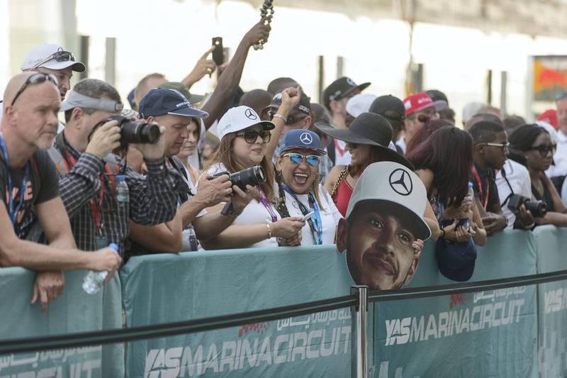 Abu Dhabi, United Arab Emirates, November 23, 2017:    Fans walk through pit lane during previews for the Abu Dhabi Formula One Grand Prix at Yas Marina Circuit in Abu Dhabi on November 23, 2017. Christopher Pike / The NationalReporter: John McAuley, Graham CaygillSection: Sport