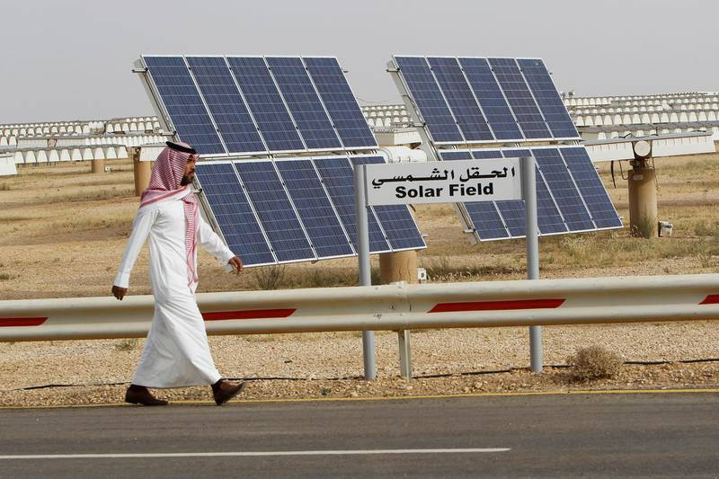A Saudi man walks on a street past a field of solar panels at the King Abdulaziz city of Sciences and Technology, Al-Oyeynah Research Station, May 21, 2012. Saudi Arabia, the world's top oil exporter, may finally be getting serious about overcoming the technical and financial hurdles for tapping its other main resource: sunshine. Saudi Arabia wants to generate much more solar power as it lacks coal or enough natural gas output to meet rapidly rising power demand. Doing so would allow it to slash the volume of oil it burns in power plants bankrolled by billions of dollars worth of saved oil earnings. Picture taken May 21, 2012. To match story SAUDI-SOLAR/  REUTERS/Fahad Shadeed   (SAUDI ARABIA - Tags: ENERGY BUSINESS) - GM1E85N1O8301