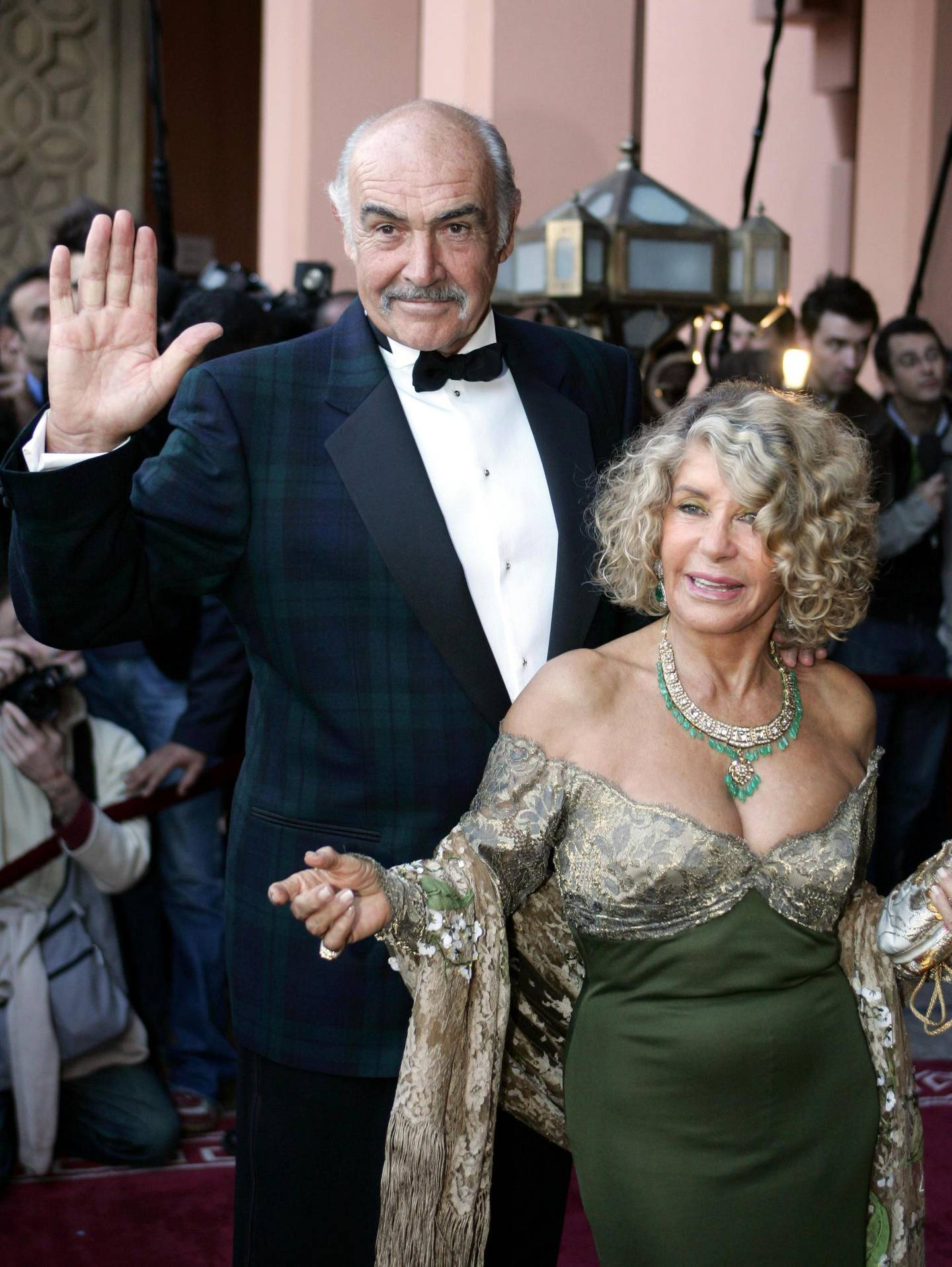 """(FILES) In this file photo taken on December 07, 2004 British actor Sean Connery and his wife, Micheline Roquebrune, arrive for the presentation of """"Alexendre,"""" directed by Oliver Stone, during the 44th International Film Festival in Marrakesh. Legendary British actor Sean Connery, best known for playing fictional spy James Bond in seven films, has died aged 90, his family told the BBC on on October 31, 2020. The Scottish actor, who was knighted in 2000, won numerous awards during his decades-spanning career, including an Oscar, three Golden Globes and two Bafta awards.  / AFP / Jack GUEZ"""