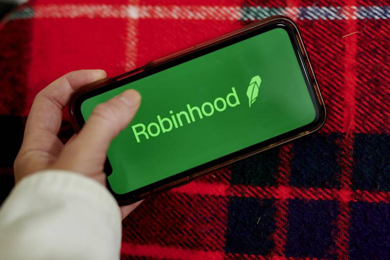 The logo for Robinhood is displayed on a smartphone in an arranged photograph taken in the Brooklyn borough of New York, U.S., on Monday, Oct. 12, 2020. Even though the firm said this year that it has more than doubled its customer-service team, clients complain they're struggling to get quick help when their funds are disappearing. Photographer: Gabby Jones/Bloomberg