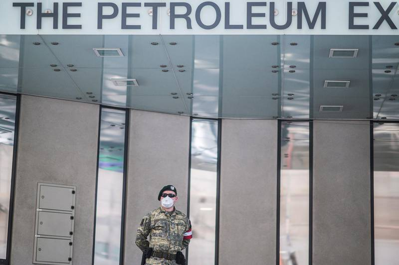 epa08353338 An Austrian Armed Forces soldier wearing a face mask patrols in front of the Organization of Petroleum Exporting Countries (OPEC) headquarters in Vienna, Austria, 09 April 2020. According to reports Ministers of the OPEC member states discuss SARS-CoV-2 coronavirus, which causes the Covid-19 disease, effects on the oil business in a video conference today.  EPA/CHRISTIAN BRUNA