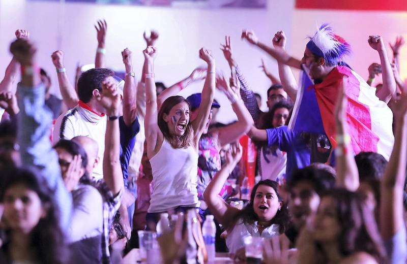 DUBAI , UNITED ARAB EMIRATES , JULY 15 – 2018 :- Supporters of France celebrating after France won the World Cup final match against Croatia at The Dome in Dubai Sports City in Dubai. ( Pawan Singh / The National )  For News. Story by Patrick