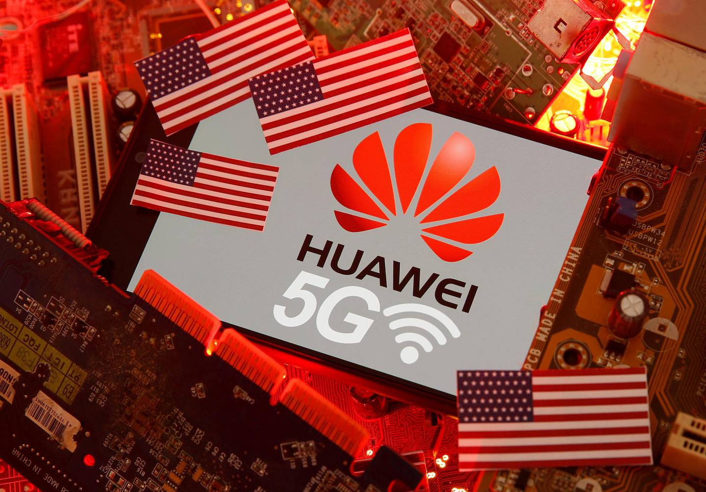 FILE PHOTO: The U.S. flag and a smartphone with the Huawei and 5G network logo are seen on a PC motherboard in this illustration taken January 29, 2020. REUTERS/Dado Ruvic/Illustration/File Photo