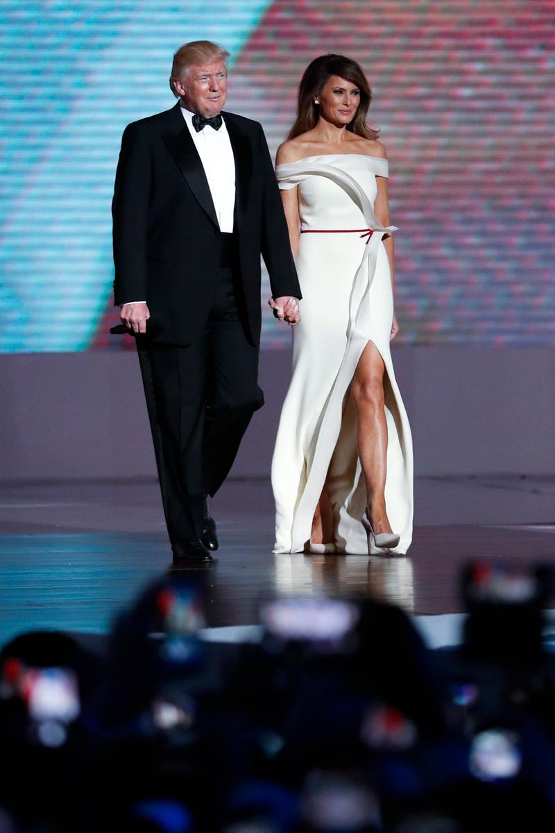 epa05737035 US President Donald J. Trump (L) and his wife First Lady Melania Trump (R) arrive at the Liberty Ball after being sworn in as the 45th President of the United States in Washington, DC, USA, 20 January 2017. Trump won the 08 November 2016 election to become the next US President.  EPA/SHAWN THEW