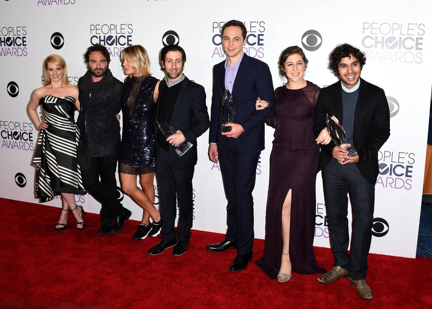 """(FILES) In this file photo taken on January 6, 2016 the ast of The Big Bang Theory poses in the press Room at the People's Choice Awards 2016 at Microsoft Theater in Los Angeles, California. - Award-winning ratings smash """"The Big Bang Theory"""" will end with the finale of its 12th season in May next year, CBS said on August 22, 2018, lavishing praise on the long-running comedy. (Photo by Angela WEISS / AFP)"""