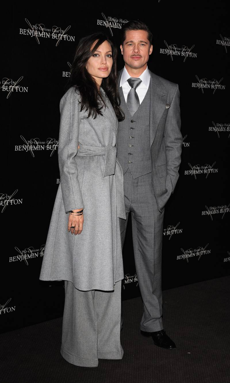 """PARIS - JANUARY 22:  Brad Pitt and Angelina Jolie arrive to attend """"The Curious Case of Benjamin Button"""" Paris Premiere on January 22, 2009 at Gaumont Marignan in Paris  (Photo by Pascal Le Segretain/Getty Images)"""