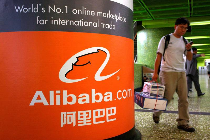 epa06710592 (FILE) - A file photo dated 22 October 2007 shows a man walking past an Alibaba.com Ltd. advertising billboard in Hong Kong, China (re-issued 04 May 2018). Alibaba on 04 May 2018 reported their fiscal year 2018 results, saying their full year revenue grew 58 per cent to 39,898 million USD and core commerce revenue grew 60 per cent, while profit growth reached over 40 per cent and annual free cash flow was at 15.8 billion USD. Alibaba says they expect overall revenue for fiscal year 2019 to grow above 60 per cent.  EPA/YM