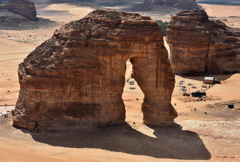 (FILES) This file photo taken on February 11, 2019, shows an aerial view of the Elephant rock in the Ula desert near the northwestern Saudi town of al-Ula. Saudi Arabia said on September 27, 2019 it will offer tourist visas for the first time, opening up the ultra-conservative kingdom to holidaymakers as part of a push to diversify its economy away from oil. Kickstarting tourism is one of the centrepieces of Crown Prince Mohammed bin Salman's Vision 2030 reform programme to prepare the biggest Arab economy for a post-oil era.   / AFP / FAYEZ NURELDINE