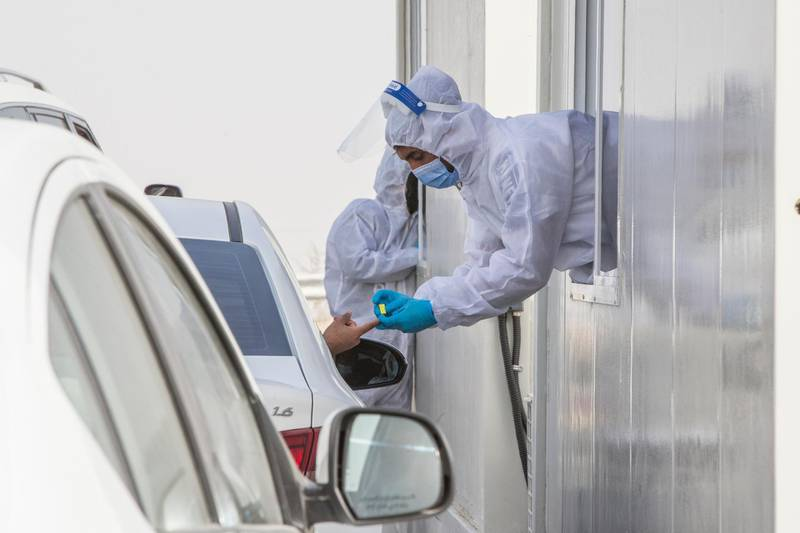 Dubai, United Arab Emirates - A passenger inside the car being tested by pricking blood sample before entering the Abu Dhabi at the new DPI Testing Centres border of Dubai and Abu Dhabi.  Leslie Pableo for The National for Shireena Al Nowais story