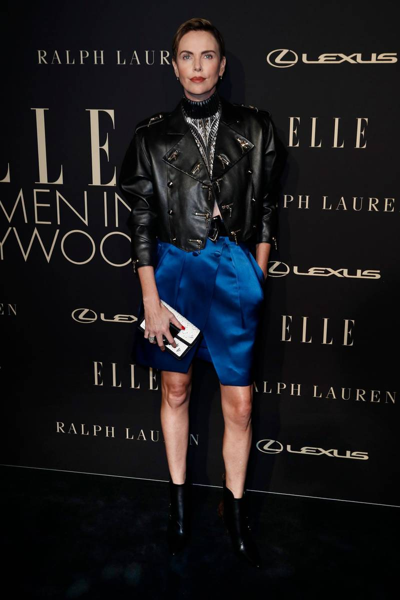 epa07921722 South African-American actress Charlize Theron poses on the red carpet during the 26th Annual ELLE Women in Hollywood Celebration, Beverly Hills, California, USA, 14 October 2019.  EPA-EFE/ETIENNE LAURENT