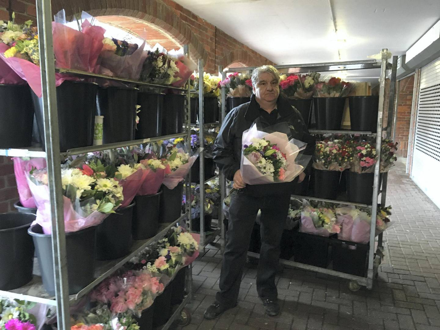 Mark Fitzpatrick with his unsold flowers in Salisbury. Photo by Paul Peachey