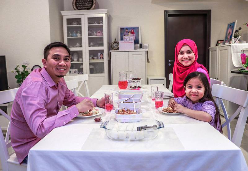 Abu Dhabi, U.A.E., May 29, 2018.  Images people of different nationalities and backgrounds at iftar time to show the type of food they eat, for a series on international iftar. This family is from Malaysia.  Azura Yunos with her husband Mudzaffa Reza and their daughter Mishel (5).Victor Besa / The NationalReporter:  Hala KhalafSection:  Arts & Life