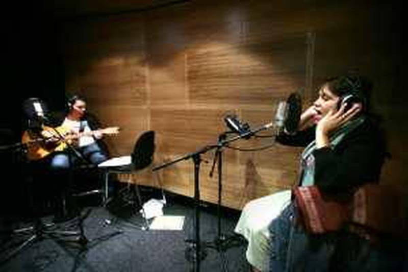 SYDNEY, AUSTRALIA. 07 APRIL 2009: Singers Kaleena Briggs (R) and Nardi Simpson record a track at Gadigal Studios April 7, 2009 in Sydney, Australia.  (Photo by Ian Waldie.) *** Local Caption ***  IW_Aboriginal_Music_005.jpg