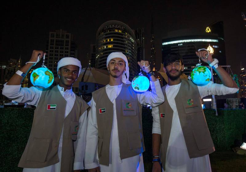 DUBAI, UNITED ARAB EMIRATES - Local boys with their earth lanterns during Earth Hour at the DEWA, Earth Hour at Mirasi Promenade, Dubai.  Leslie Pableo for The National