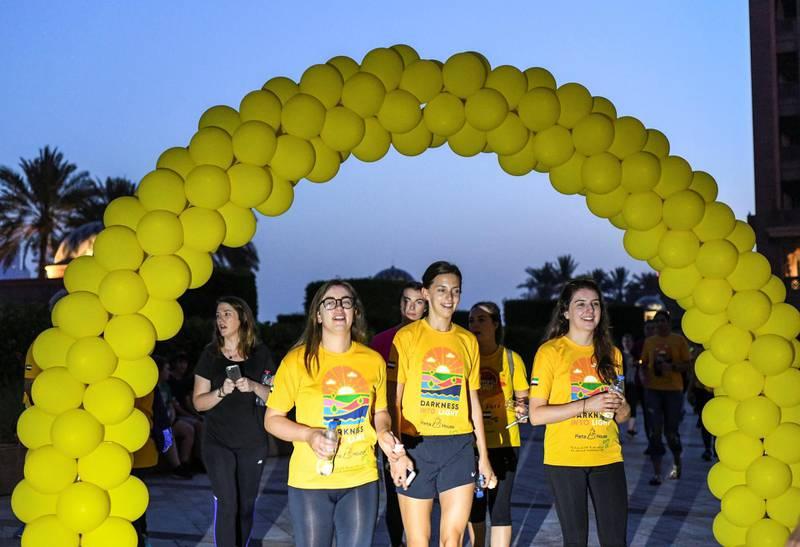 Abu Dhabi, United Arab Emirates - The finish line at the ÔDarkness into LightÕ walk at Emirates Palace. Khushnum Bhandari for The National
