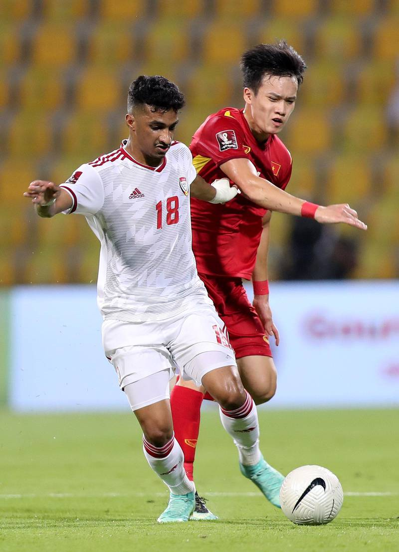 UAE's Abdullah Ramadan battles with Nguyễn Tiến Linh (L) of Vietnam during the game between the UAE and Vietnam in the World cup qualifiers at the Zabeel Stadium, Dubai on June 15th, 2021. Chris Whiteoak / The National. Reporter: John McAuley for Sport
