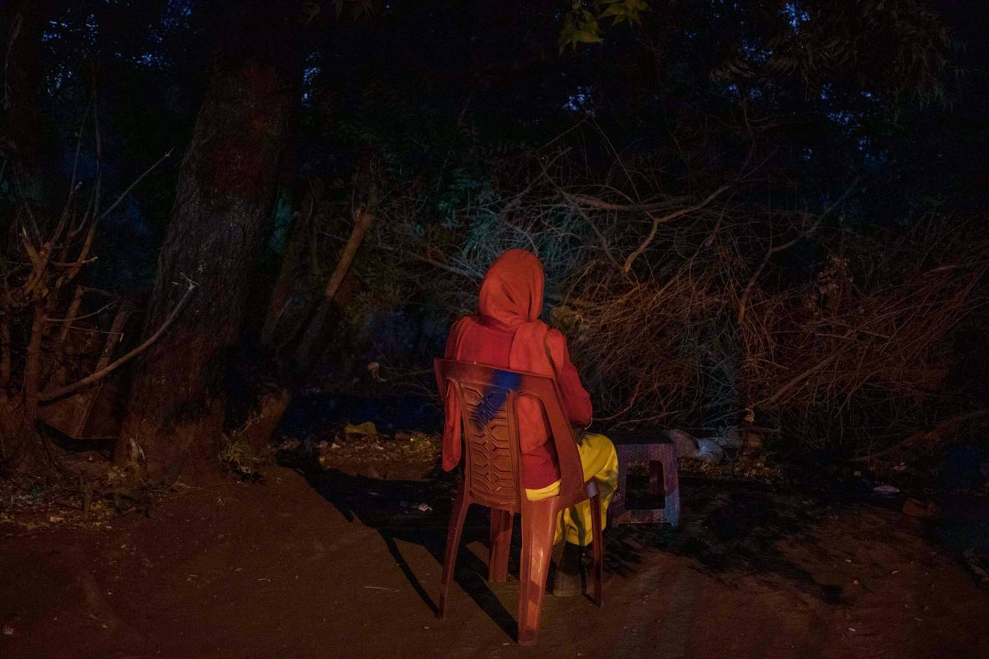 This Jan. 12, 2020 photo shows 22-year-old Mayada, a tea vendor 7-months pregnant with twins, the result of a gang-rape by Sudanese security forces, in Khartoum, Sudan. Dozens of women were raped on June 3, 2019 as security forces attacked a sit-in protest camp in Khartoum, according to activists' counts. Mayada wanted to end the pregnancy, but a pharmacist refused to sell her pills to cause an abortion. She hurt herself, lifting heavy objects and throwing herself off furniture, hoping for a miscarriage. She gave birth in March to a daughter, while the other twin, a boy, died. She doesn't know the names of the men who raped her, much less which is the father. (AP Photo/Nariman El-Mofty)