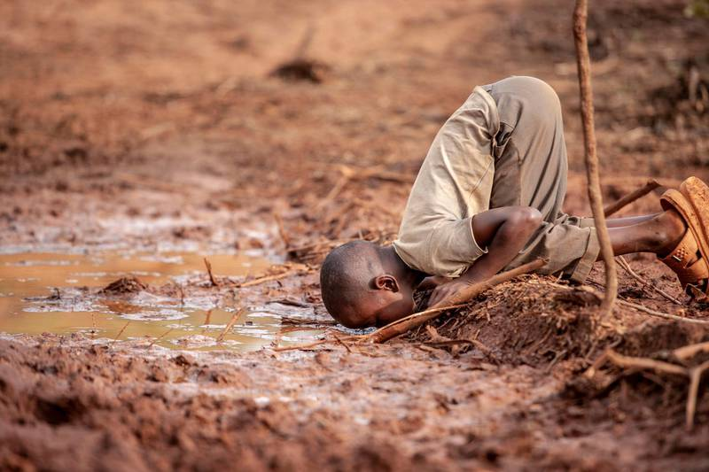 Frederick Dharshie Wissah - Water Scarcity (Kakamega, Kenya)A young boy drinking dirty water due to lack of water points in the area due to deforestation thus this leading to health risks to the boy