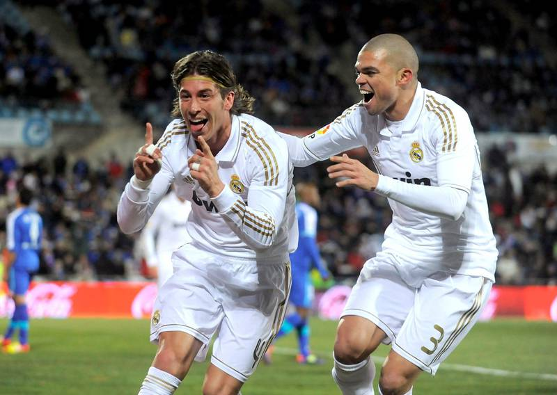 GETAFE, SPAIN - FEBRUARY 04:  Sergio Ramos (L) and Pepe of Real Madrid celebrate after Ramos scored Real's opening goal against Getafe during the La Liga match between Getafe and Real Madrid at Coliseum Alfonso Perez stadium on February 4, 2012 in Getafe, Spain.  (Photo by Denis Doyle/Getty Images) at Coliseum Alfonso Perez on February 4, 2012 in Getafe, Spain.  (Photo by Denis Doyle/Getty Images)