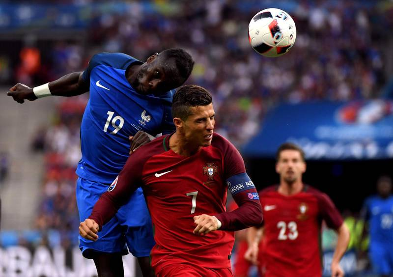PARIS, FRANCE - JULY 10:  Bacary Sagna of France wins a header above Cristiano Ronaldo of Portugal during the UEFA EURO 2016 Final match between Portugal and France at Stade de France on July 10, 2016 in Paris, France.  (Photo by Mike Hewitt/Getty Images)