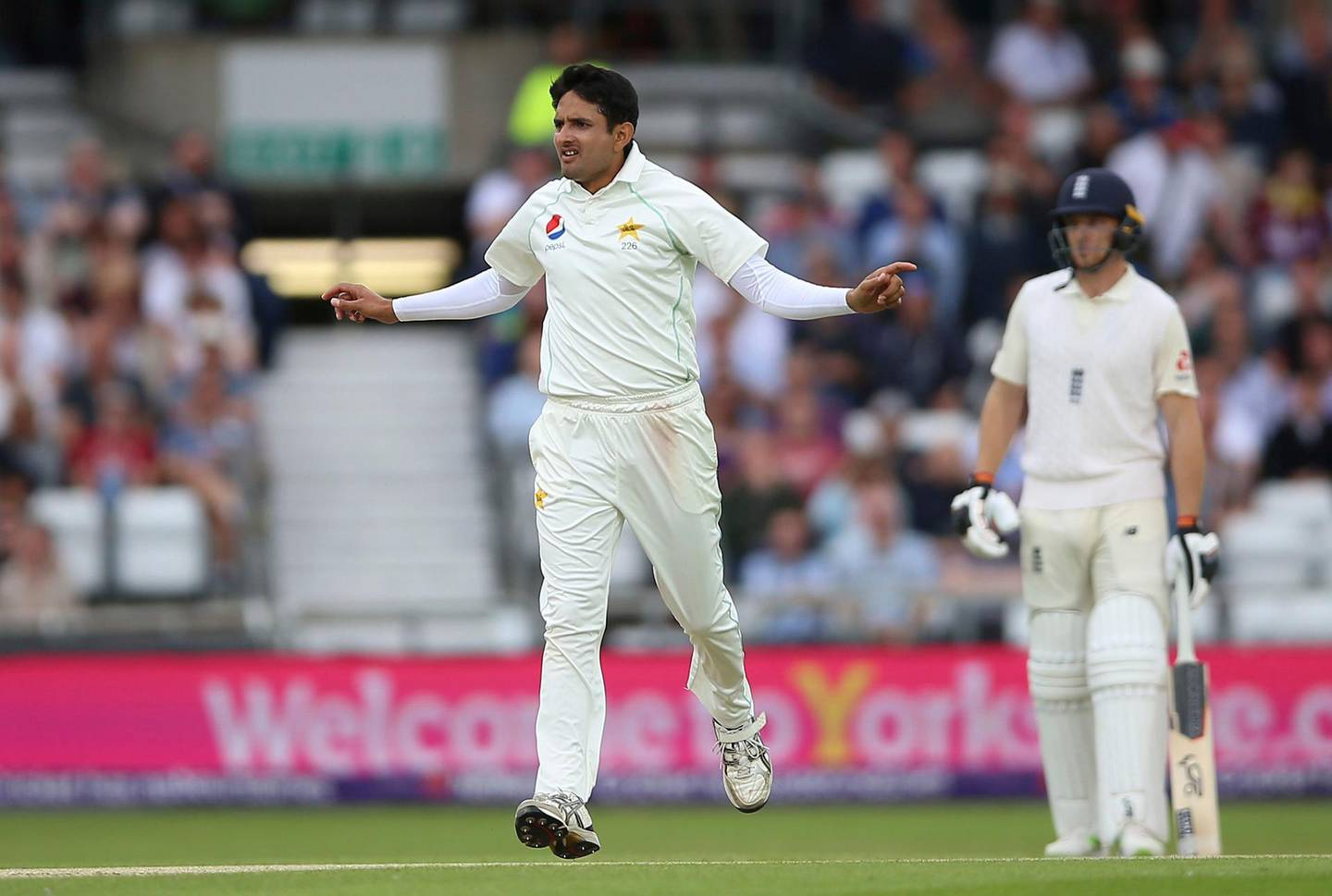 Pakistan's Mohammad Abbas celebrates after taking the wicket of England's Sam Curran on day three of the second test match at Headingley, Leeds, England, Sunday June 3, 2018. (Nigel French/PA via AP)