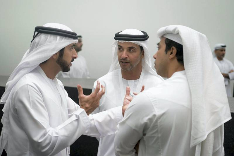 SAADIYAT ISLAND, ABU DHABI, UNITED ARAB EMIRATES - September 11, 2017: HH Sheikh Hamdan bin Mohamed Al Maktoum, Crown Prince of Dubai (L), HH Sheikh Hazza bin Zayed Al Nahyan, Vice Chairman of the Abu Dhabi Executive Council (C), and HH Sheikh Mansour bin Zayed Al Nahyan, UAE Deputy Prime Minister and Minister of Presidential Affairs (R), tour the Louvre Abu Dhabi.   ( Hamad Al Kaabi / Crown Prince Court - Abu Dhabi ) ���