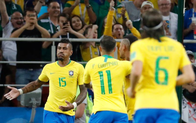 epa06845507 Paulinho (L) of Brazil celebrates after scoring a goal during the FIFA World Cup 2018 group E preliminary round soccer match between Serbia and Brazil in Moscow, Russia, 27 June 2018.  (RESTRICTIONS APPLY: Editorial Use Only, not used in association with any commercial entity - Images must not be used in any form of alert service or push service of any kind including via mobile alert services, downloads to mobile devices or MMS messaging - Images must appear as still images and must not emulate match action video footage - No alteration is made to, and no text or image is superimposed over, any published image which: (a) intentionally obscures or removes a sponsor identification image; or (b) adds or overlays the commercial identification of any third party which is not officially associated with the FIFA World Cup)  EPA/FELIPE TRUEBA   EDITORIAL USE ONLY