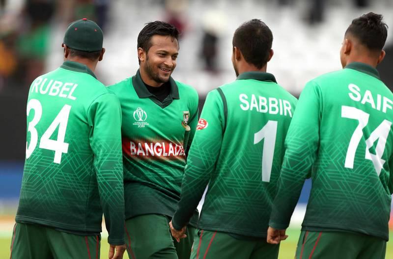 Bangladesh's Shakib Al Hasan, second left, and teammates celebrate winning the Cricket World Cup match between West Indies and Bangladesh at The Taunton County Ground, Taunton, south west England, Monday June 17, 2019. (David Davies/PA via AP)