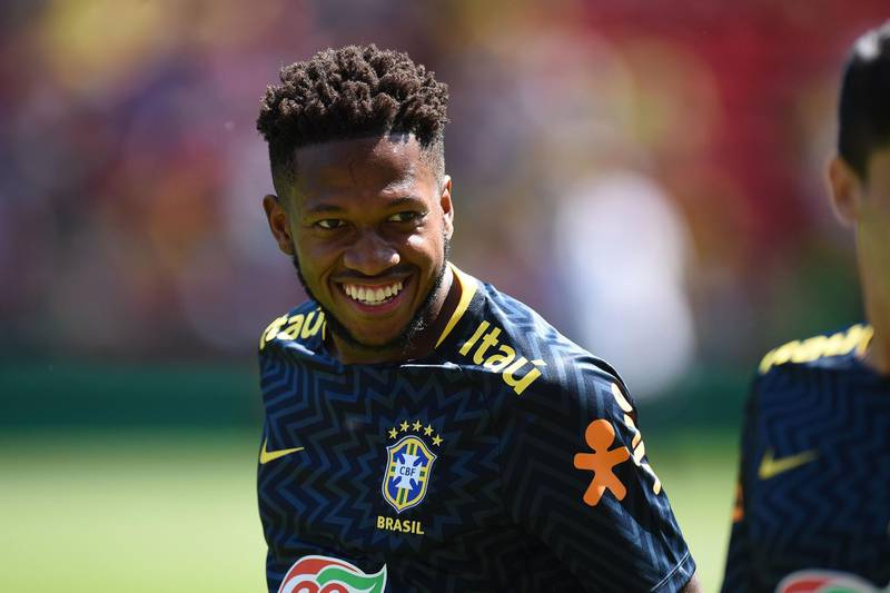 Brazil's midfielder Fred smiles as he warms up ahead of the International friendly football match between Brazil and Croatia at Anfield in Liverpool on June 3, 2018.  / AFP / Oli SCARFF