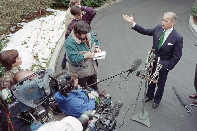 """US Senator Joseph Biden, D-Del., speaks to reporters after meeting with US President Bill Clinton at the White House on February 10, 1995 to discuss Dr. Henry Foster's nomination for surgeon general. - Calling Clinton's choice a """"political blunder in teh extreme"""", Biden told reporters that the president should withdraw the nomination and move on. (Photo by David AKE / AFP)"""