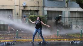 Protests erupt in Chile after street performer shot by police