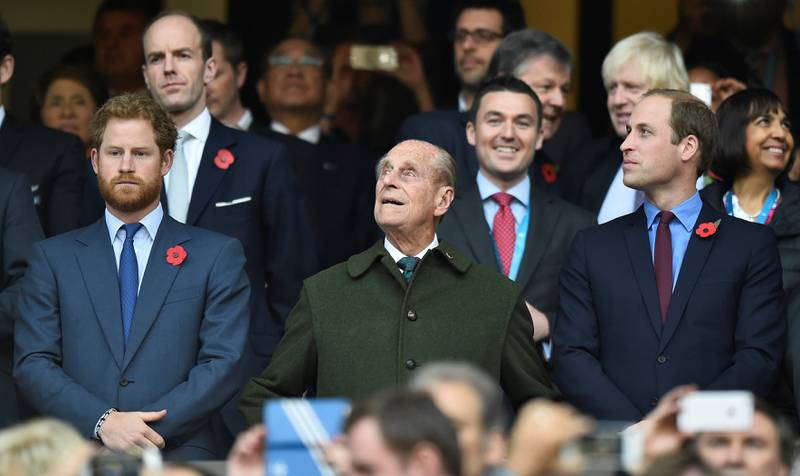 FILE PHOTO: Britain's Prince Harry, Prince Philip and Prince William (L-R) attend the Rugby World Cup final match between New Zealand against Australia at Twickenham in London, Britain October 31, 2015.    REUTERS/Toby Melville/File Photo