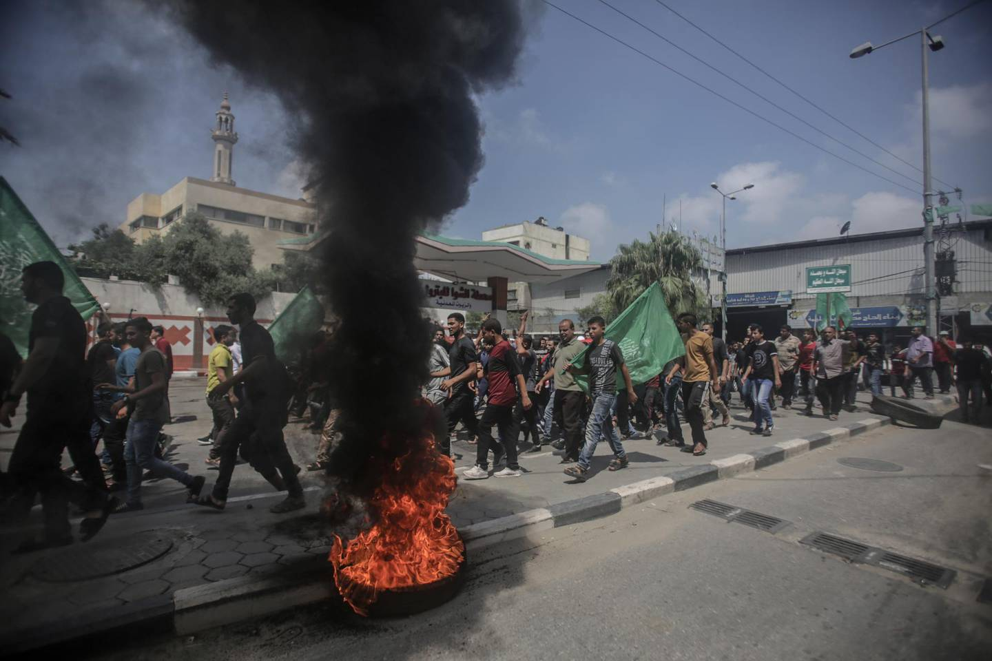 epa06870430 Palestinians attend the funeral of Mohammed Jamal Abu Halima, 22, in the neighborhood of Al- Shejaeiya east of Gaza City on, 07 July 2018. Mohammed, 22, was shot dead during the clashes after Friday protest along the border between Israel and Gaza Strip.  EPA/HAITHAM IMAD