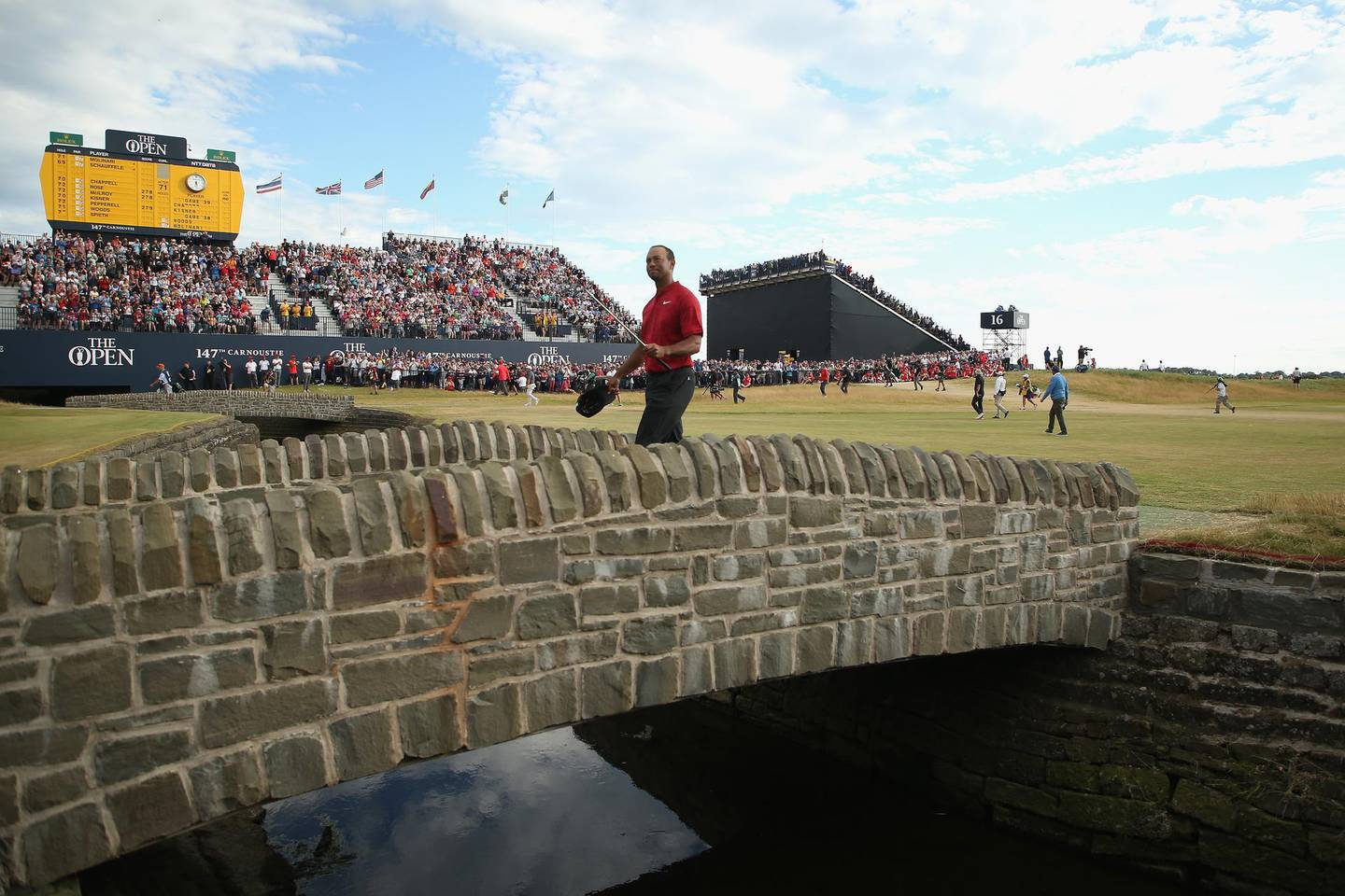 CARNOUSTIE, SCOTLAND - JULY 22:   Tiger Woods of the United States crosses the bridge on the 18th hole during the final round of the 147th Open Championship at Carnoustie Golf Club on July 22, 2018 in Carnoustie, Scotland.  (Photo by Francois Nel/Getty Images)