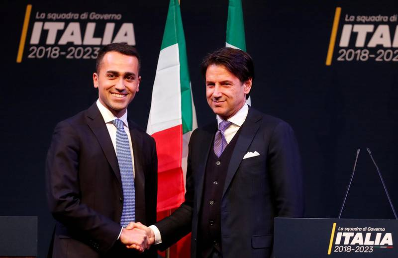 FILE PHOTO: 5-Star Movement leader Di Maio shakes hands with Giuseppe Conte in Rome ahead of Italy's election, March 1, 2018. REUTERS/Remo Casilli/File Photo