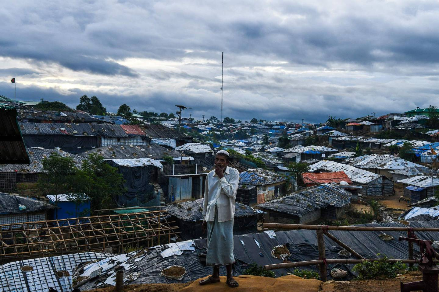 A Rohingya refugee man stands before Kutupalong camp in Ukhia near Cox's Bazar on August 13, 2018. - Nearly 700,000 Rohingya fled Myanmar's Rakhine state last year to escape a violent military crackdown. (Photo by CHANDAN KHANNA / AFP)