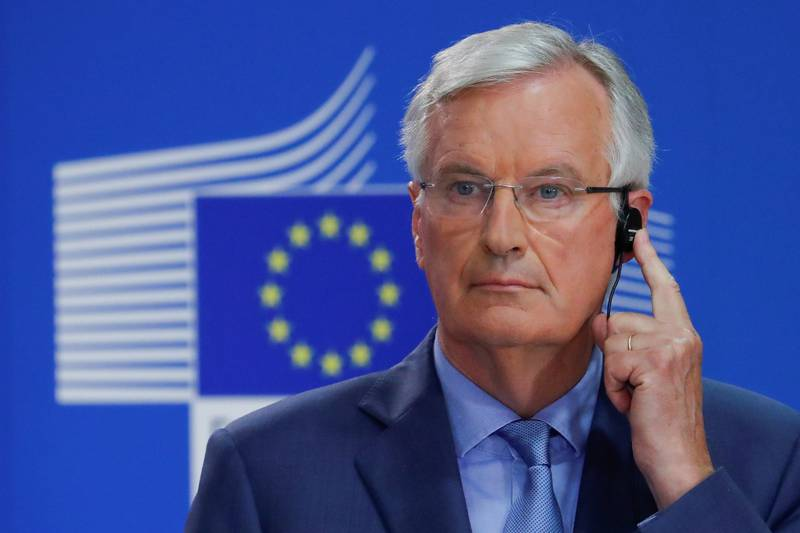 FILE PHOTO: European Union's chief Brexit negotiator Michel Barnier listens to a translation during a news conference in Brussels, Belgium July 26, 2018. REUTERS/Yves Herman/File Photo
