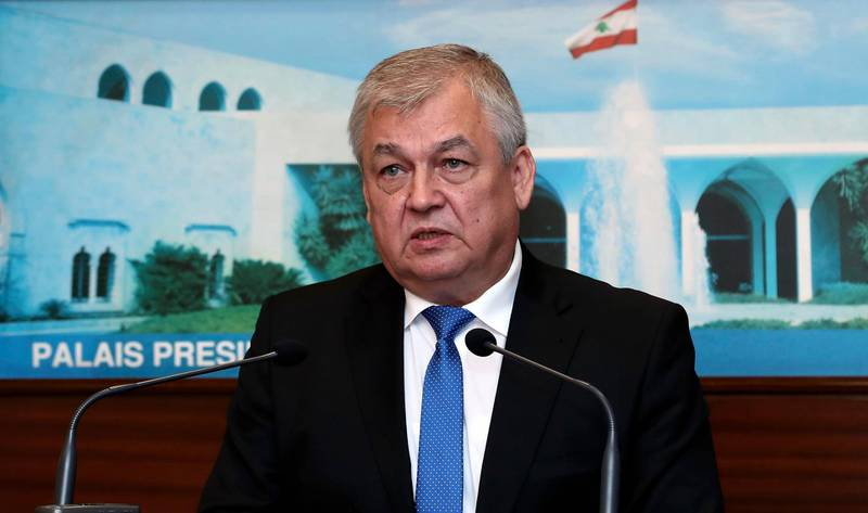 In this photo released by Lebanon's official government photographer Dalati Nohra, Russia's special presidential envoy to Syria Alexander Lavrentiev, speaks to journalist at the presidential palace, in Baabda east of Beirut, Lebanon, Thursday, July 26, 2018. The Russian delegation is in Lebanon to discuss Russian proposals for organizing the return of Syrian refugees from Lebanon and Syria to their homes in Syria. (Dalati Nohra via AP)