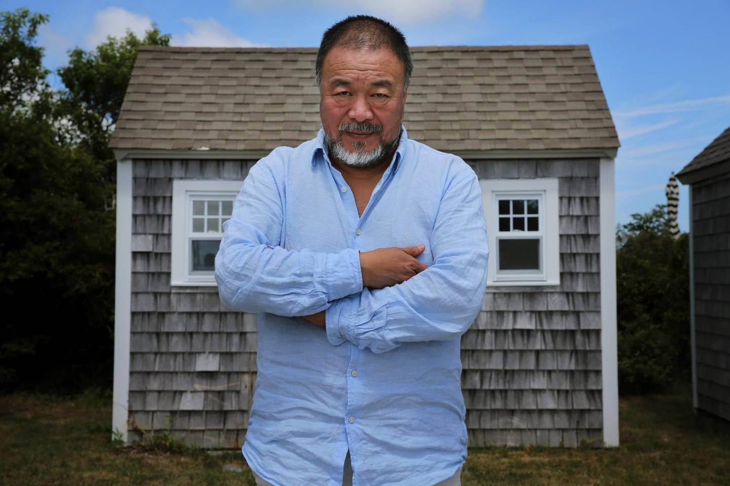 """TRURO, MA - JULY 21: Artist Ai Weiwei poses for a portrait while visiting Truro, MA on July 21, 2018. Weiwei was on Cape Cod to receive the Distinguished Artistic Achievement Award from the Fine Arts Work Center in Provincetown, where he is exhibiting his work """"Rebar and Case"""" through August 30. (Photo by Craig F. Walker/The Boston Globe via Getty Images)"""