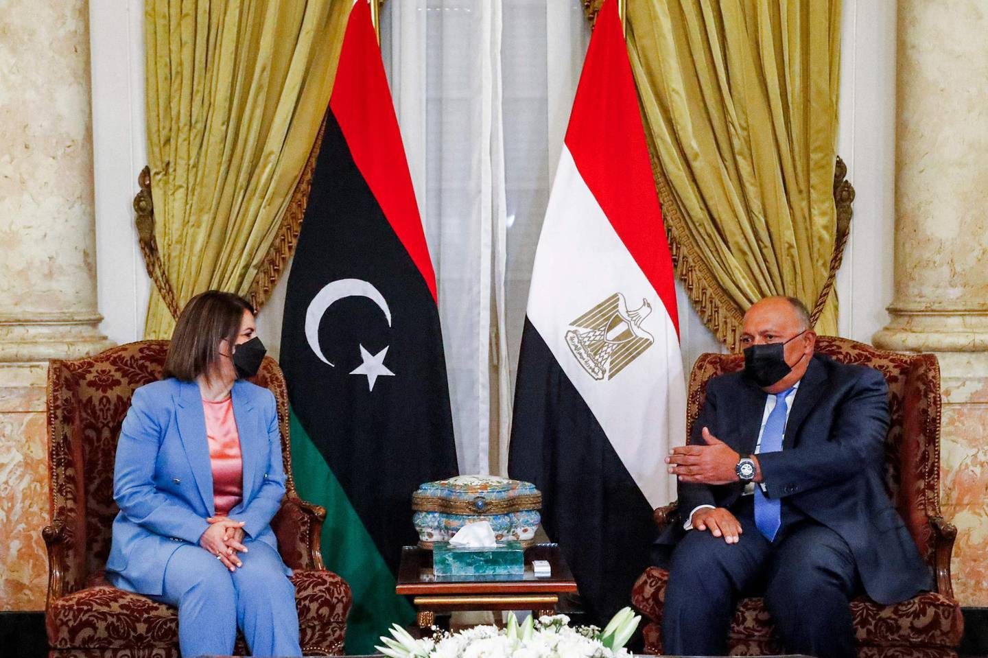 Egypt's Foreign Minister Sameh Shoukri (R) meets with his Libyan counterpart Najla al-Mangoush (L) in the capital Cairo on June 19, 2021. / AFP / Khaled DESOUKI